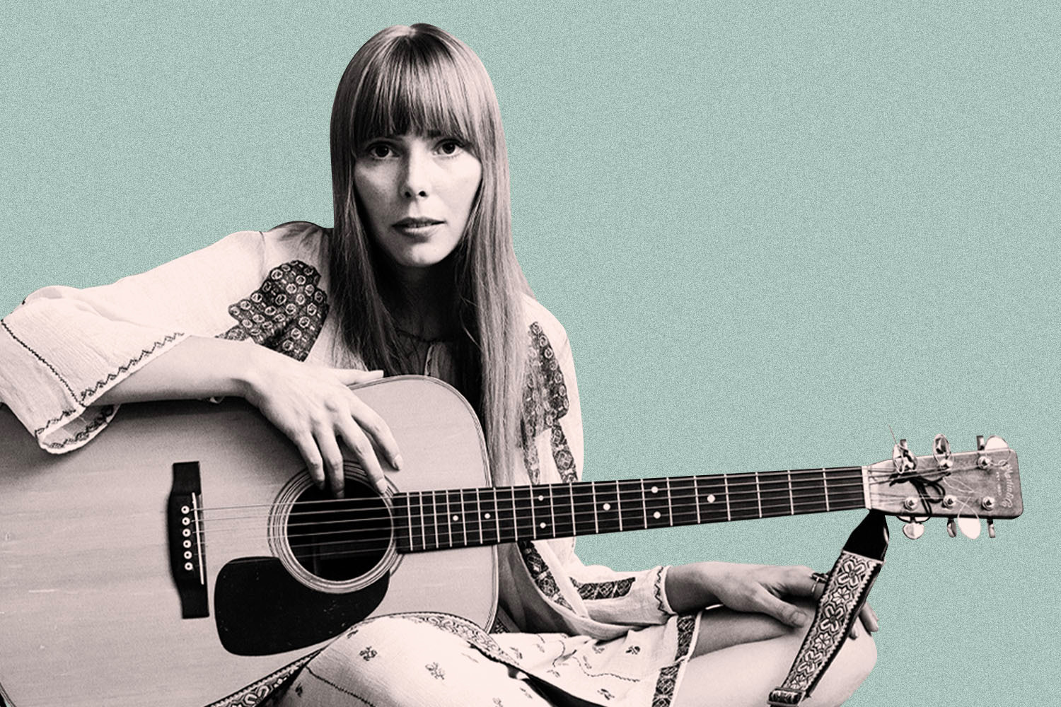 Black and white image of Joni Mitchell holding guitar, on light blue background